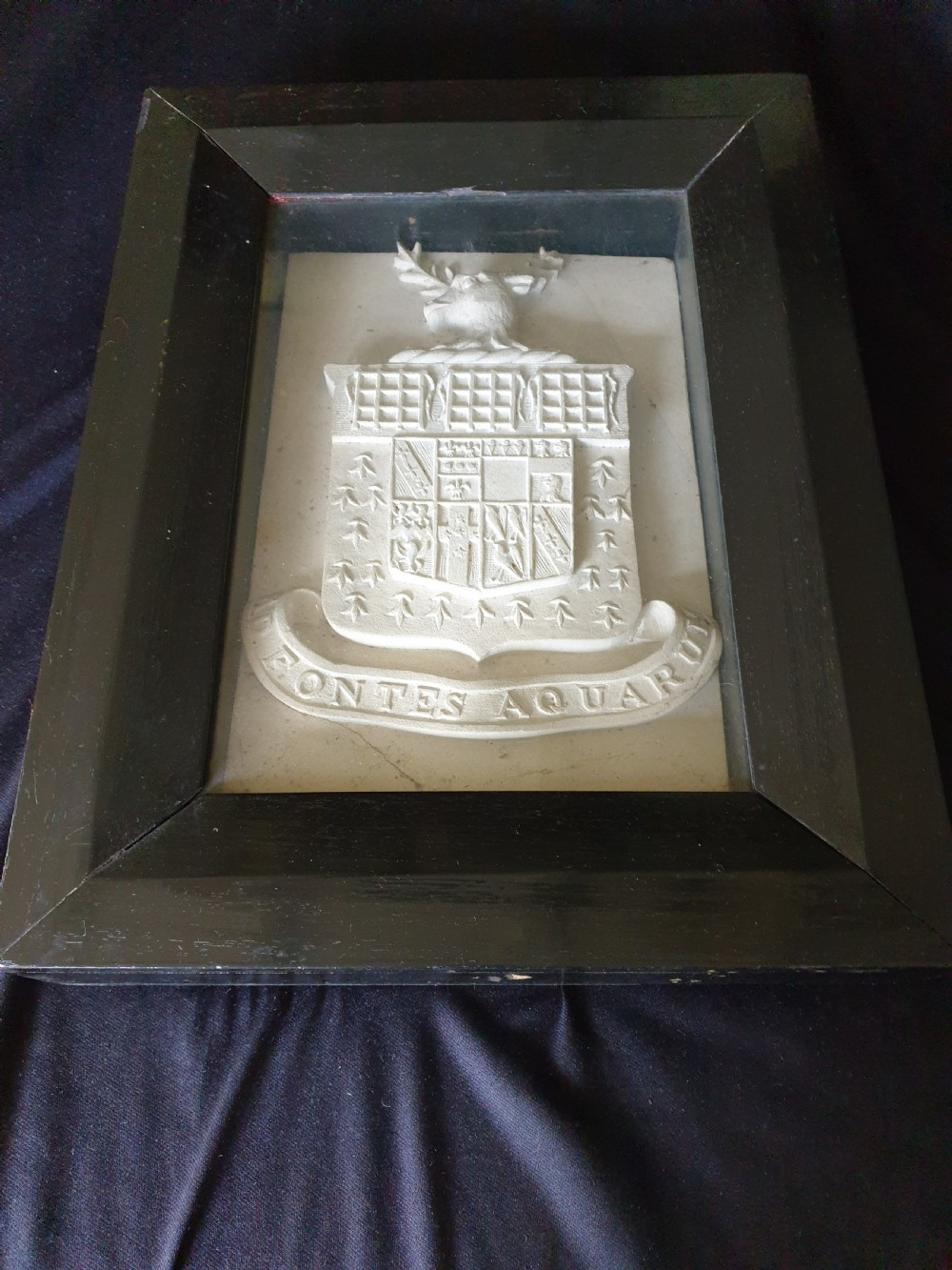 an interesting 17thc carved white stone coat of arms framed could be earlier
