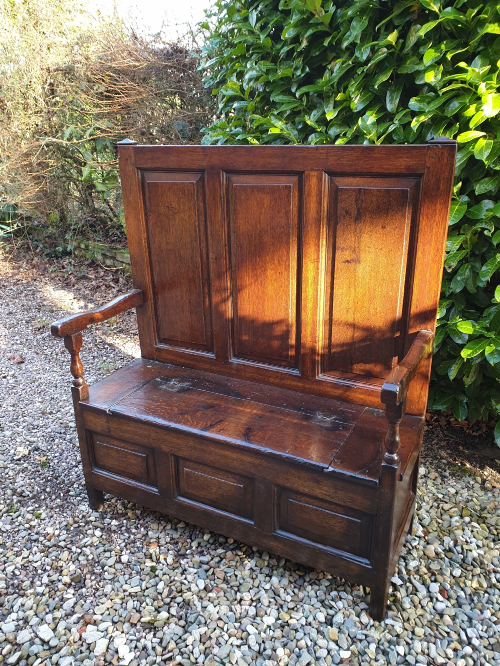 an extremely small high backed 18thc oak box seat settle with storage