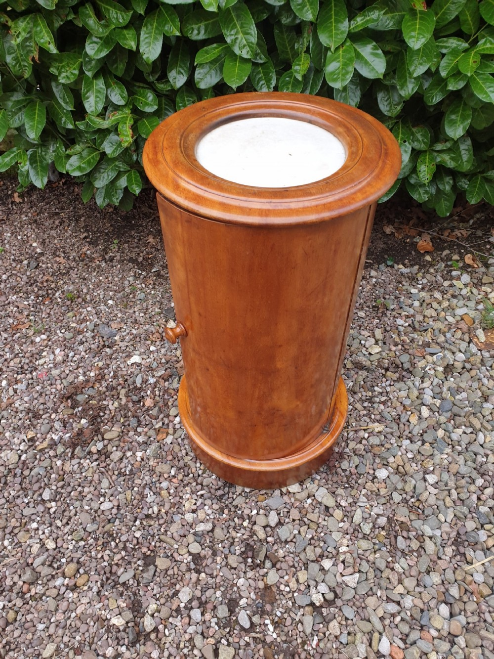 a 19thc round mahogany marble topped night stand with door